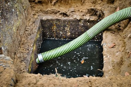 septic repair with vacuum hose